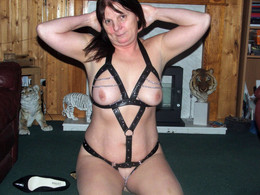 Flabby bodied MILF posing in fishnet..