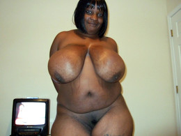 Sexy thick black woman with big tits..