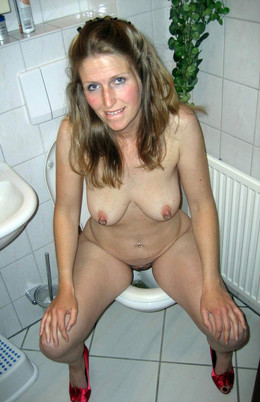 Busty wife pissing in toilet in..