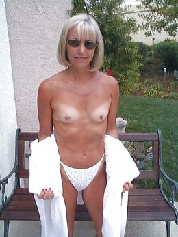 Blonde mom undressing near pool