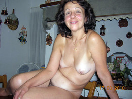 Naughty mature lady naked at home