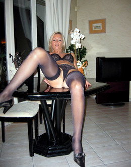 Strict blonde mature woman posing..