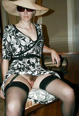 Beddable MILF in sexy corset and black..